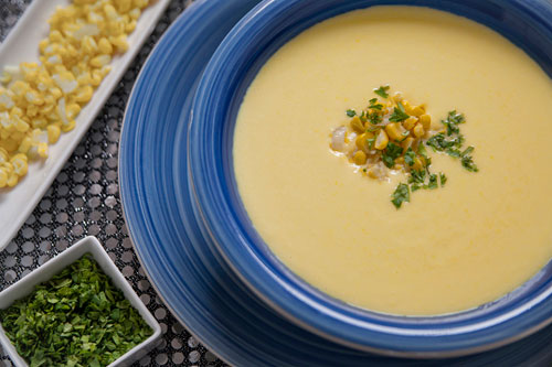 Cream of Corn Soup garnished with coriander and golden corn
