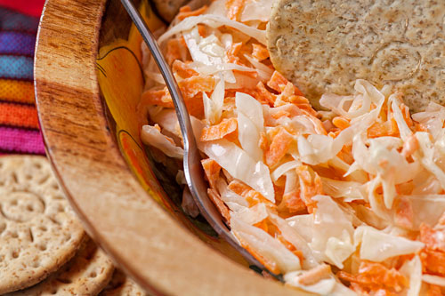 Coleslaw salad accompanied with crackers