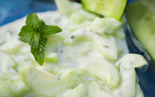 Cucumber and Yogurt Salad garnished with spearmint leaf