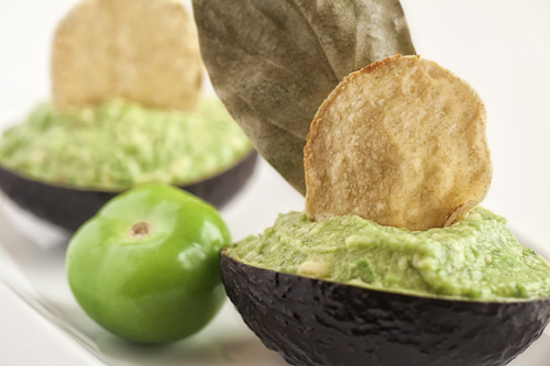 Tomatillo Guacamole presented with a tortilla chip